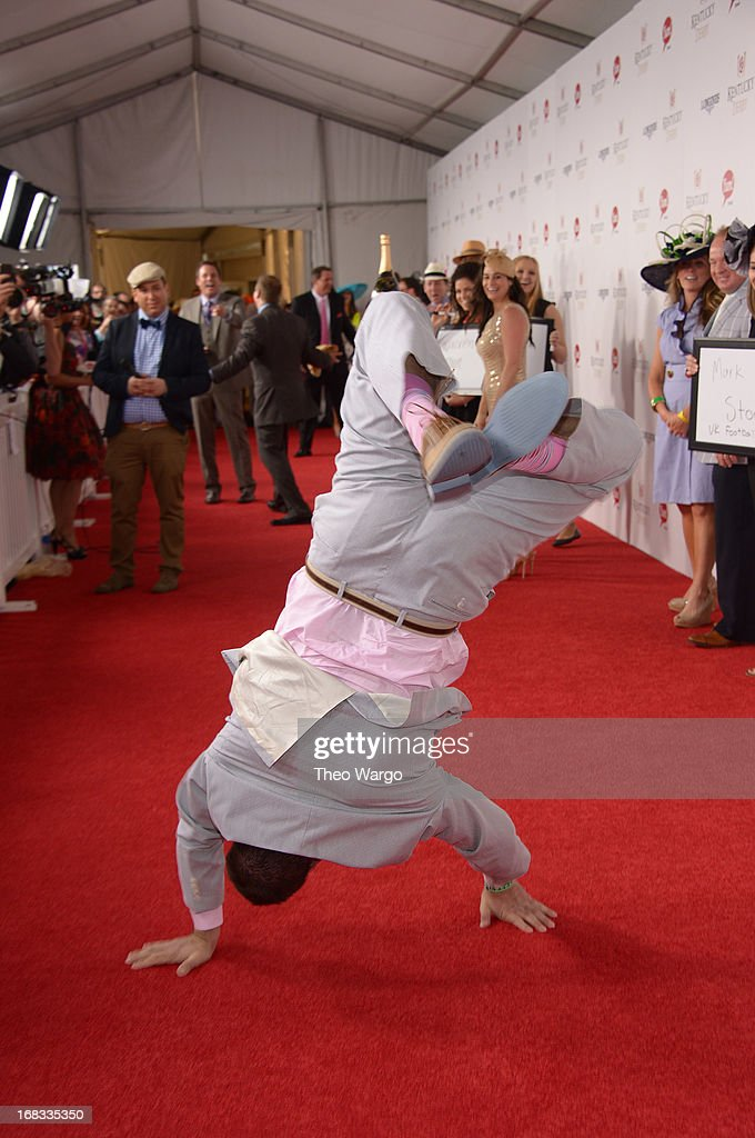 Evan Lamana does hand stands at the GREY GOOSE Red Carpet Lounge at the Kentucky Derby at Churchill Downs on May 4, 2013 in Louisville, Kentucky.