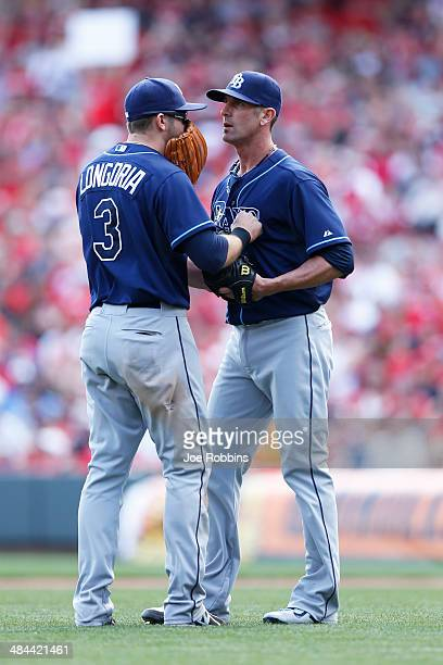 Evan Longoria and Grant Balfour of the Tampa Bay Rays talk prior to the ninth inning of the game against the Cincinnati Reds at Great American Ball...