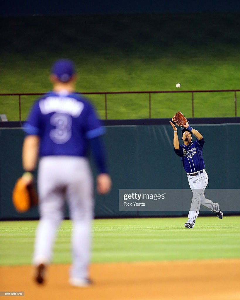 <a gi-track='captionPersonalityLinkClicked' href=/galleries/search?phrase=Evan+Longoria&family=editorial&specificpeople=2349329 ng-click='$event.stopPropagation()'>Evan Longoria</a> #3 looks on as Desmond Jennings #8 of the Tampa Bay Rays makes the catch on a pop up hit by Mitch Moreland #18 of the Texas Rangers at Rangers Ballpark in Arlington on April 9, 2013 in Arlington, Texas.