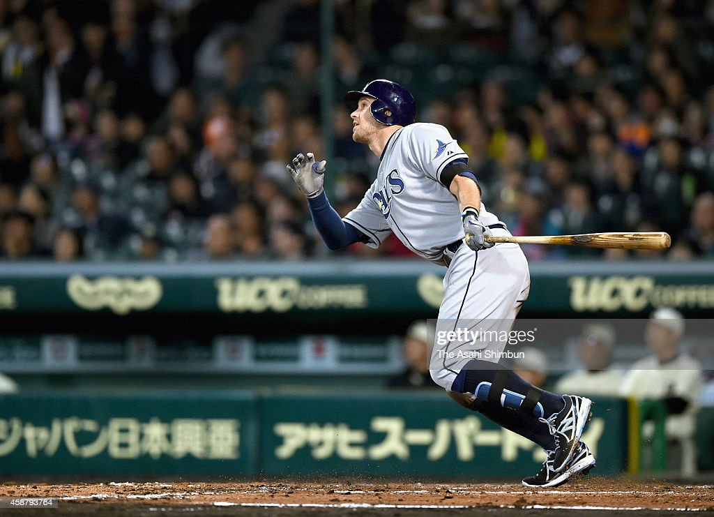 <a gi-track='captionPersonalityLinkClicked' href=/galleries/search?phrase=Evan+Longoria&family=editorial&specificpeople=2349329 ng-click='$event.stopPropagation()'>Evan Longoria</a> of Tampa Bay Rays hits a grand slam in the top of 5th inning during the friendly match between Yomiuri Giants & Hanshin Tigers and MLB All Stars at hanshin Koshien Stadium on November 11, 2014 in Nishinomiya, Hyogo, Japan.