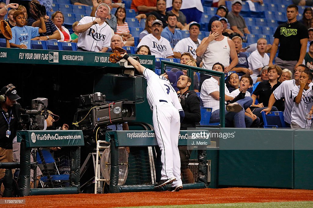 Evan Longoria #3 of the Tampa Bay Rays catches a foul ball near the television cameras for an out against the Houston Astros during the game at Tropicana Field on July 12, 2013 in St. Petersburg, Florida.