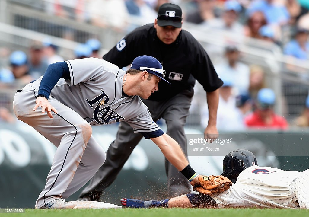 Evan Longoria of the Tampa Bay Rays catches Brian Dozier of the Minnesota Twins stealing third base during the fifth inning of the game on May 16...
