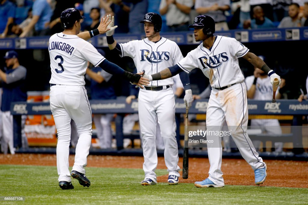 Evan Longoria #3 of the Tampa Bay Rays celebrate with teammates Daniel Robertson #29 (C) and Tim Beckham #1 after scoring off of a two-run double by Rickie Weeks during the seventh inning of a game against the New York Yankees on May 19, 2017 at Tropicana Field in St. Petersburg, Florida.