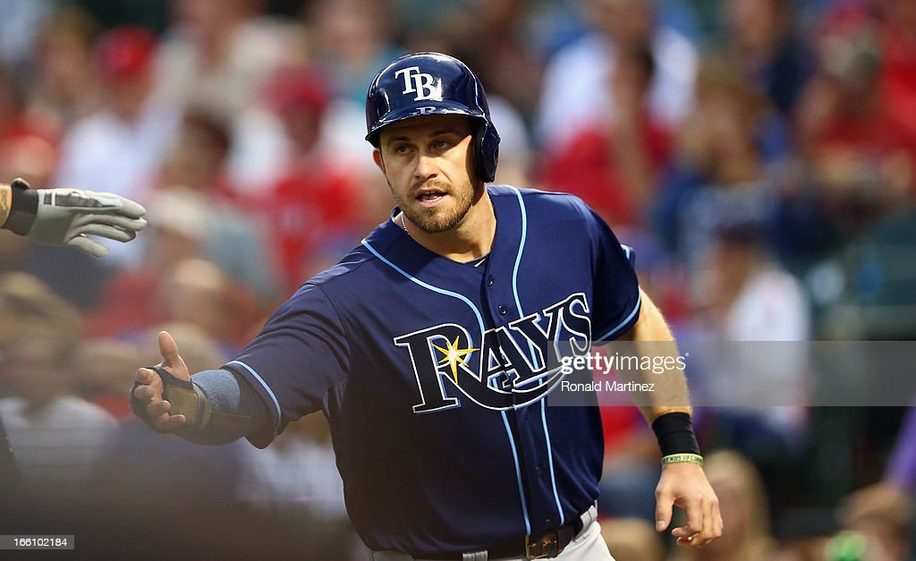 <a gi-track='captionPersonalityLinkClicked' href=/galleries/search?phrase=Evan+Longoria&family=editorial&specificpeople=2349329 ng-click='$event.stopPropagation()'>Evan Longoria</a> #3 of the Tampa Bay Rays celebrates a run against the Texas Rangers at Rangers Ballpark in Arlington on April 8, 2013 in Arlington, Texas.