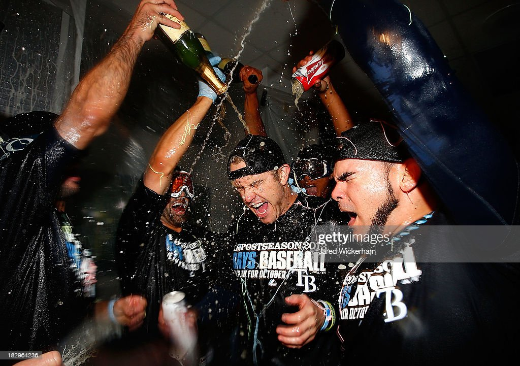 Evan Longoria #3 of the Tampa Bay Rays celebrates in the clubhouse with his teammates following their 4-0 win against the Cleveland Indians during the American League Wild Card game at Progressive Field on October 3, 2013 in Cleveland, Ohio.