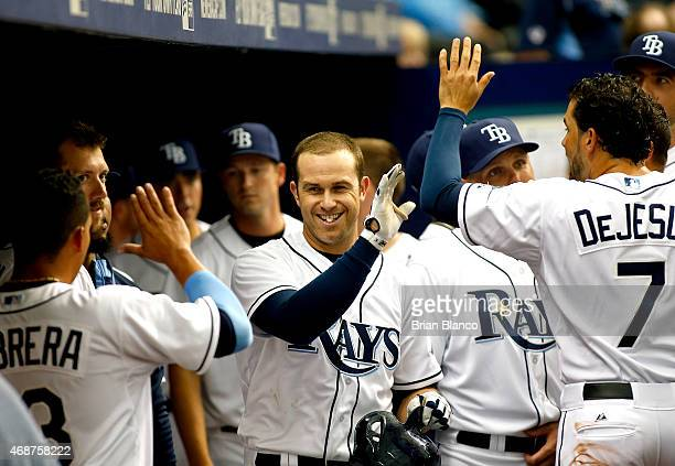 Evan Longoria of the Tampa Bay Rays celebrates in the dugout after hitting a solo home run during the seventh inning of a Opening Day game against...