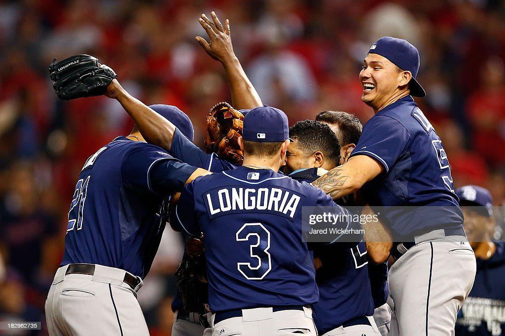 Evan Longoria #3 of the Tampa Bay Rays celebrates with his teammates after defeating the Cleveland Indians in the American League Wild Card game at Progressive Field on October 2, 2013 in Cleveland, Ohio.