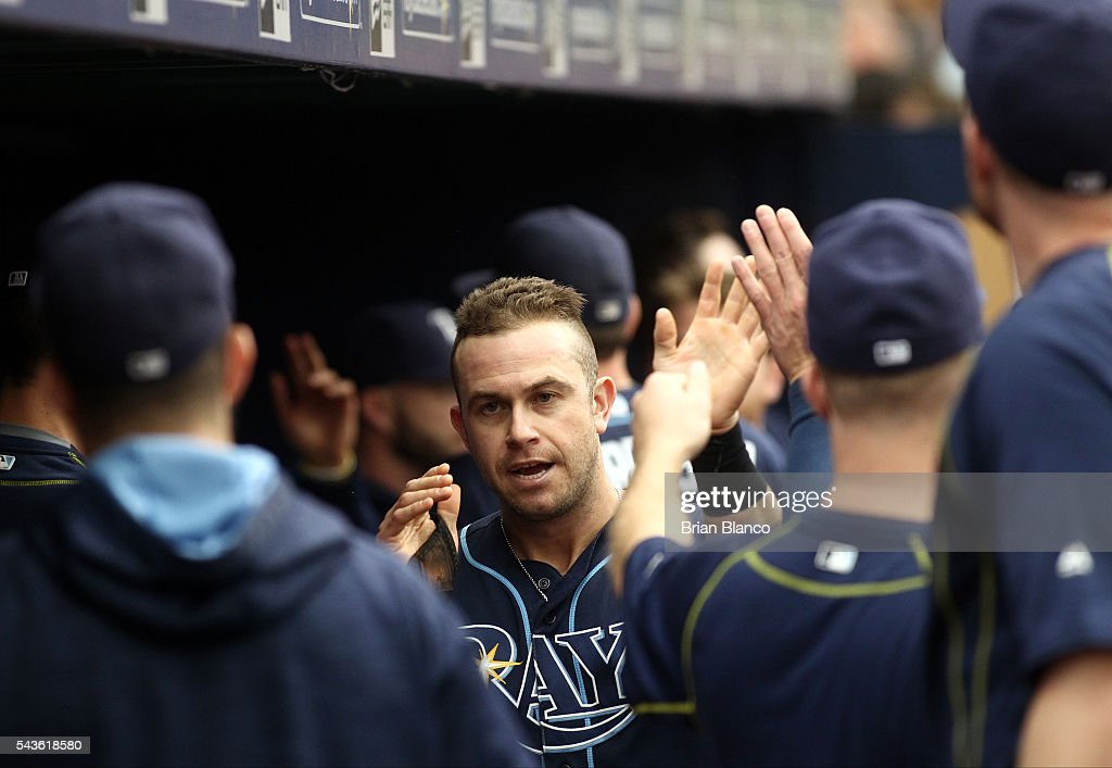 <a gi-track='captionPersonalityLinkClicked' href=/galleries/search?phrase=Evan+Longoria&family=editorial&specificpeople=2349329 ng-click='$event.stopPropagation()'>Evan Longoria</a> #3 of the Tampa Bay Rays celebrates with teammates in the dugout after scoring off of an RBI double by Brandon Guyer during the third inning of a game on June 29, 2016 at Tropicana Field in St. Petersburg, Florida.