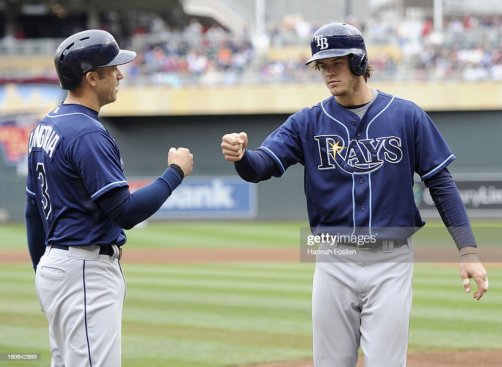 <a gi-track='captionPersonalityLinkClicked' href=/galleries/search?phrase=Evan+Longoria&family=editorial&specificpeople=2349329 ng-click='$event.stopPropagation()'>Evan Longoria</a> #3 of the Tampa Bay Rays congratulates teammate <a gi-track='captionPersonalityLinkClicked' href=/galleries/search?phrase=Wil+Myers&family=editorial&specificpeople=7562808 ng-click='$event.stopPropagation()'>Wil Myers</a> #9 after Myers hit a two run home run against the Minnesota Twins during the fourth inning of the game on September 15, 2013 at Target Field in Minneapolis, Minnesota.