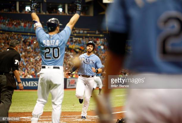 Evan Longoria of the Tampa Bay Rays crosses home plate as Steven Souza Jr #20 celebrates to score off of an RBI triple by Brad Miller during the...