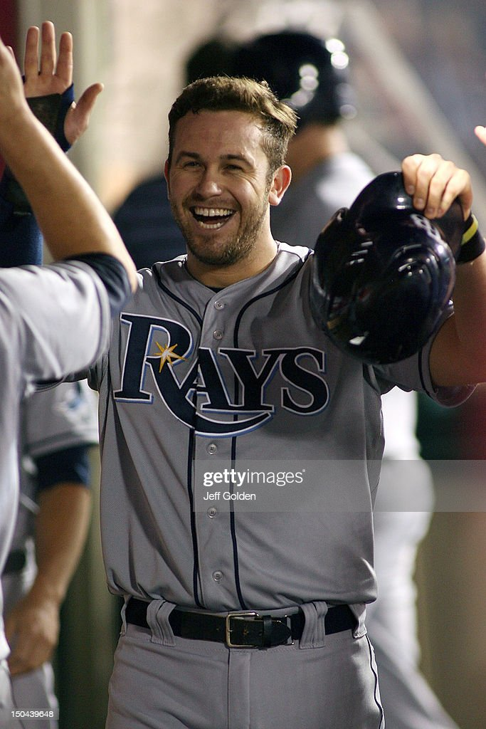 <a gi-track='captionPersonalityLinkClicked' href=/galleries/search?phrase=Evan+Longoria&family=editorial&specificpeople=2349329 ng-click='$event.stopPropagation()'>Evan Longoria</a> #3 of the Tampa Bay Rays high-fives teammates in the dugout after scoring against the Los Angeles Angels of Anaheim in the fourth inning at Angel Stadium of Anaheim on August 17, 2012 in Anaheim, California.