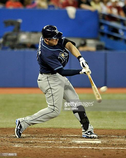 Evan Longoria of the Tampa Bay Rays hits a home run in the top of the sixth inning during MLB game action against the Toronto Blue Jays August 26...