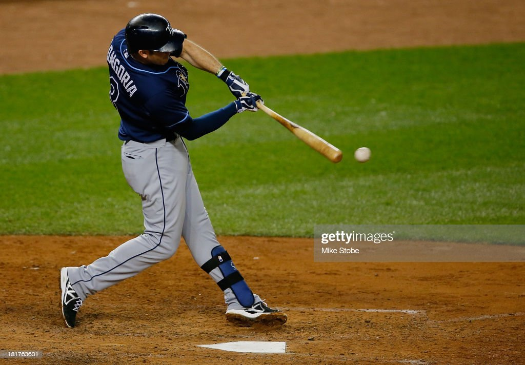 <a gi-track='captionPersonalityLinkClicked' href=/galleries/search?phrase=Evan+Longoria&family=editorial&specificpeople=2349329 ng-click='$event.stopPropagation()'>Evan Longoria</a> #3 of the Tampa Bay Rays hits a single in the fourth inning against the New York Yankees at Yankee Stadium on September 24, 2013 in the Bronx borough of New York City. The Rays defeated the Yankees 7-0.