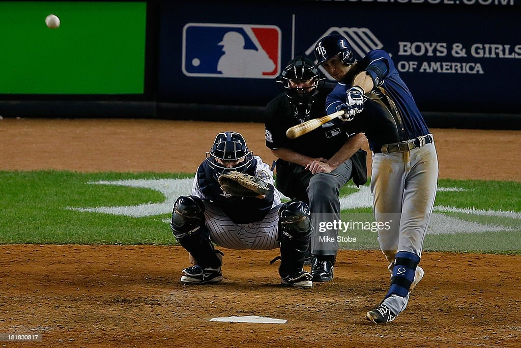 <a gi-track='captionPersonalityLinkClicked' href=/galleries/search?phrase=Evan+Longoria&family=editorial&specificpeople=2349329 ng-click='$event.stopPropagation()'>Evan Longoria</a> #3 of the Tampa Bay Rays hits a solo home run in the ninth inning against the New York Yankees at Yankee Stadium on September 25, 2013 in the Bronx borough of New York City. Rays defeated the Yankees 8-3.
