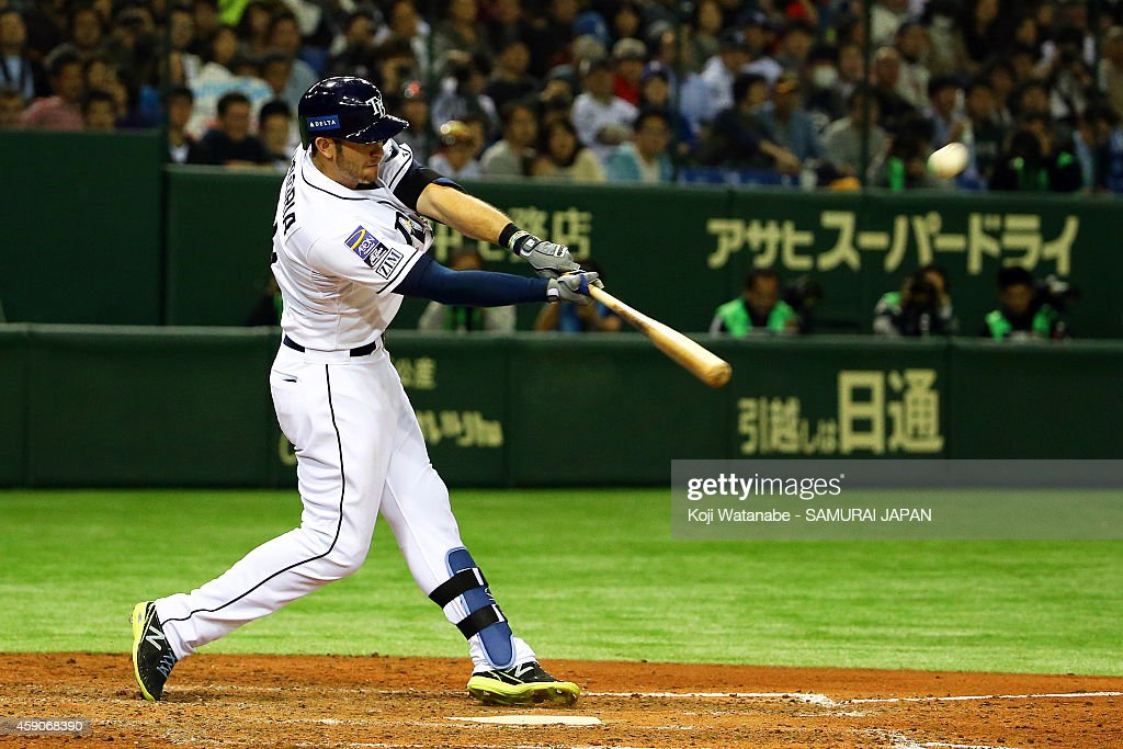 <a gi-track='captionPersonalityLinkClicked' href=/galleries/search?phrase=Evan+Longoria&family=editorial&specificpeople=2349329 ng-click='$event.stopPropagation()'>Evan Longoria</a> #3 of the Tampa Bay Rays hits a solo home run in the sixth inning during the game four of Samurai Japan and MLB All Stars at Tokyo Dome on November 16, 2014 in Tokyo, Japan.