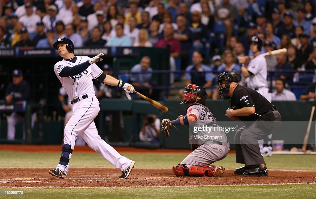 <a gi-track='captionPersonalityLinkClicked' href=/galleries/search?phrase=Evan+Longoria&family=editorial&specificpeople=2349329 ng-click='$event.stopPropagation()'>Evan Longoria</a> #3 of the Tampa Bay Rays hits a three-run home run in the fifth inning against the Boston Red Sox during Game Three of the American League Division Series at Tropicana Field on October 7, 2013 in St Petersburg, Florida.
