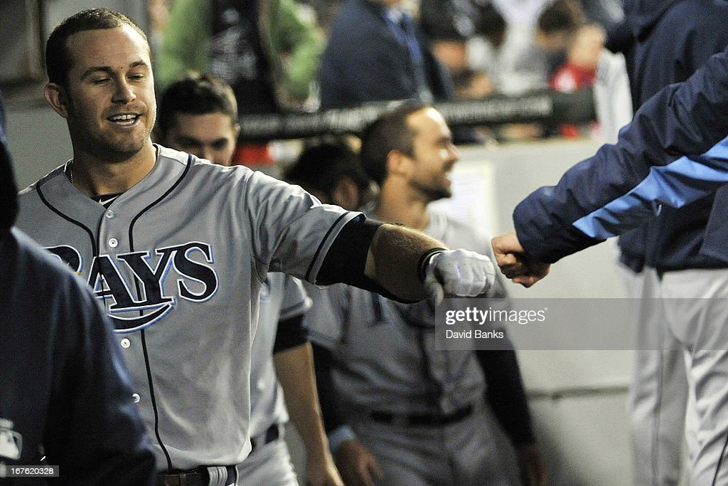 <a gi-track='captionPersonalityLinkClicked' href=/galleries/search?phrase=Evan+Longoria&family=editorial&specificpeople=2349329 ng-click='$event.stopPropagation()'>Evan Longoria</a> #3 of the Tampa Bay Rays is congratulated after hitting a home run against the Chicago White Sox during the fourth inning on April 26, 2013 at U.S. Cellular Field in Chicago, Illinois.