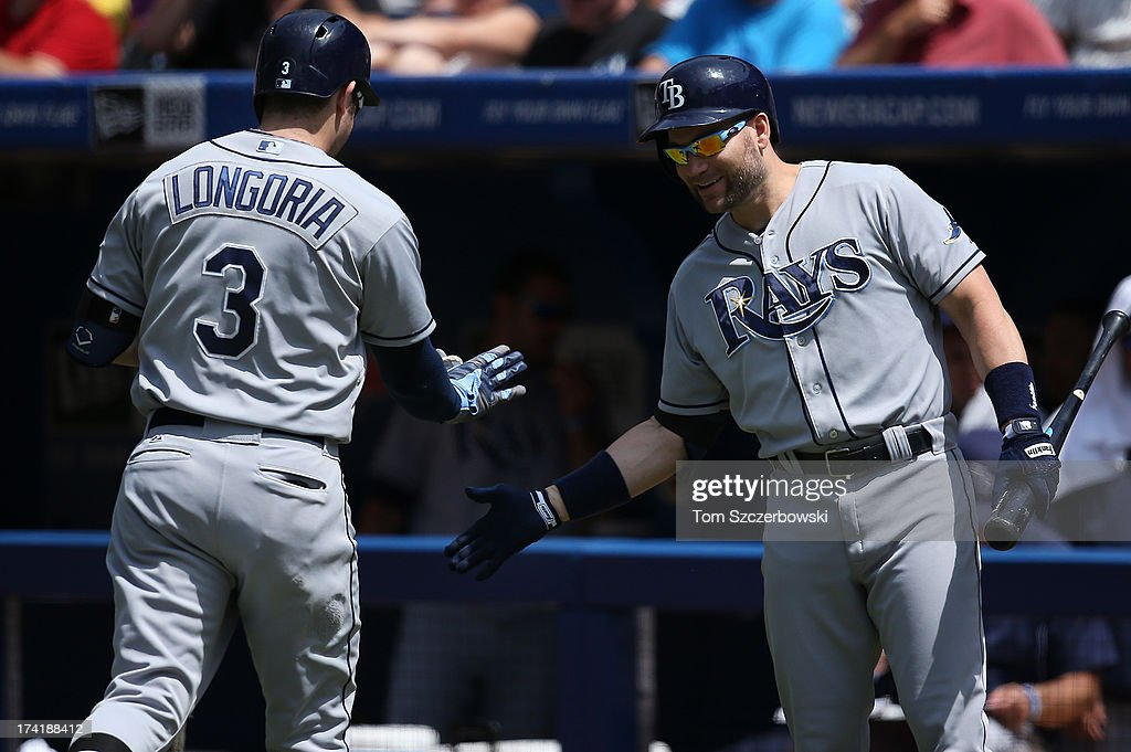 <a gi-track='captionPersonalityLinkClicked' href=/galleries/search?phrase=Evan+Longoria&family=editorial&specificpeople=2349329 ng-click='$event.stopPropagation()'>Evan Longoria</a> #30 of the Tampa Bay Rays is congratulated by <a gi-track='captionPersonalityLinkClicked' href=/galleries/search?phrase=Luke+Scott&family=editorial&specificpeople=757156 ng-click='$event.stopPropagation()'>Luke Scott</a> #30 after hitting a solo home run in the fourth inning during MLB game action against the Toronto Blue Jays on July 21, 2013 at Rogers Centre in Toronto, Ontario, Canada.