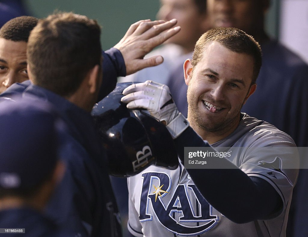 <a gi-track='captionPersonalityLinkClicked' href=/galleries/search?phrase=Evan+Longoria&family=editorial&specificpeople=2349329 ng-click='$event.stopPropagation()'>Evan Longoria</a> #3 of the Tampa Bay Rays is congratulated by teammates after scoring on a James Loney single during a game against the Kansas City Royals in the third inning at Kauffman Stadium on May 1, 2013 in Kansas City, Missouri.