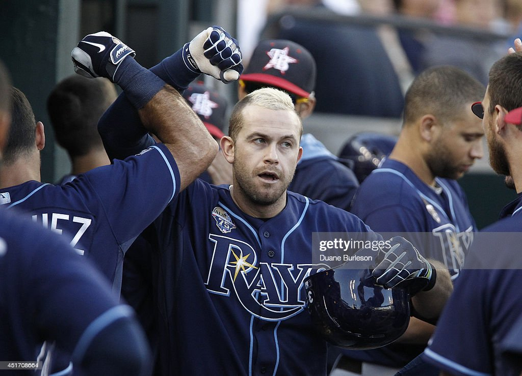 Evan Longoria #3 of the Tampa Bay Rays is congratulated in the dugout after hitting a solo home run against the Detroit Tigers during the fourth inning at Comerica Park on July 4, 2014 in Detroit, Michigan.