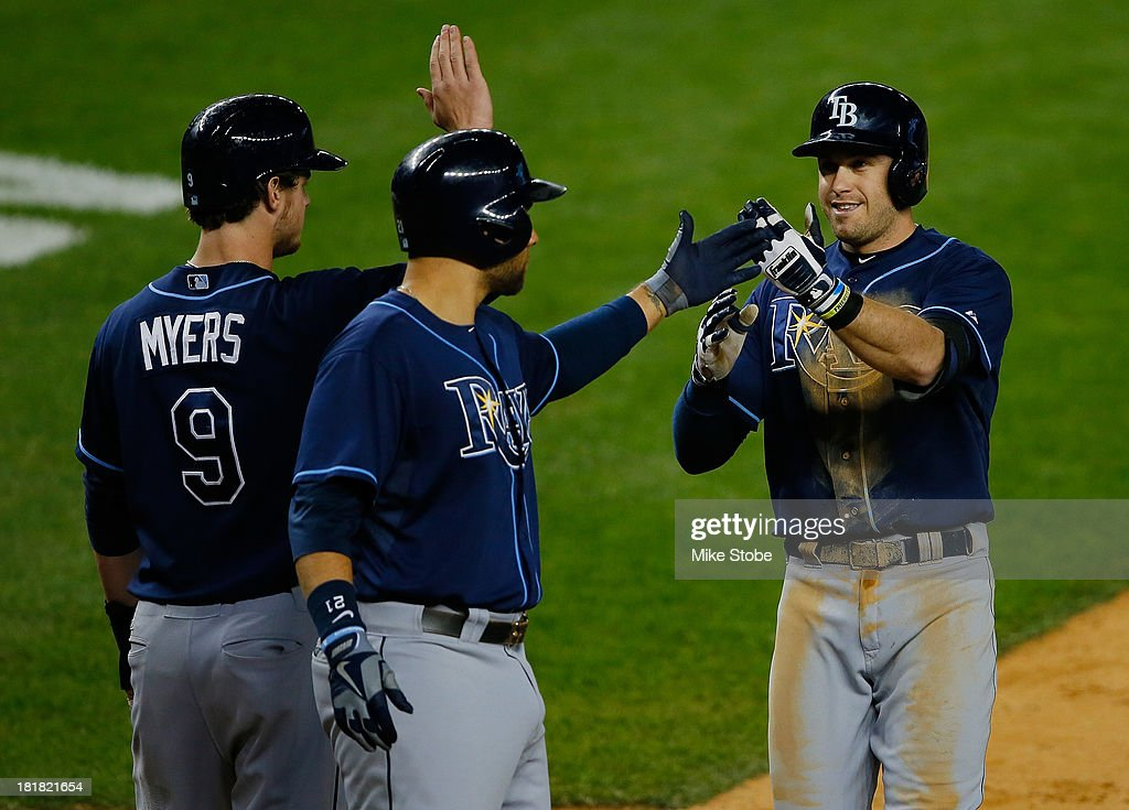 <a gi-track='captionPersonalityLinkClicked' href=/galleries/search?phrase=Evan+Longoria&family=editorial&specificpeople=2349329 ng-click='$event.stopPropagation()'>Evan Longoria</a> #3 of the Tampa Bay Rays is greeted by <a gi-track='captionPersonalityLinkClicked' href=/galleries/search?phrase=Wil+Myers&family=editorial&specificpeople=7562808 ng-click='$event.stopPropagation()'>Wil Myers</a> #9 and <a gi-track='captionPersonalityLinkClicked' href=/galleries/search?phrase=James+Loney&family=editorial&specificpeople=636293 ng-click='$event.stopPropagation()'>James Loney</a> #21 after hitting a three run home run in the sixth inning against the New York Yankees at Yankee Stadium on September 25, 2013 in the Bronx borough of New York City.