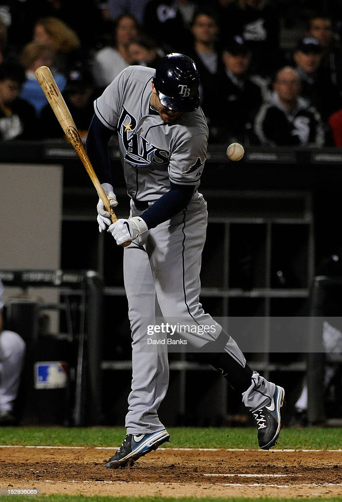 <a gi-track='captionPersonalityLinkClicked' href=/galleries/search?phrase=Evan+Longoria&family=editorial&specificpeople=2349329 ng-click='$event.stopPropagation()'>Evan Longoria</a> #3 of the Tampa Bay Rays is hit by a pitch in the eighth inning on September 28, 2012 at U.S. Cellular Field in Chicago, Illinois.