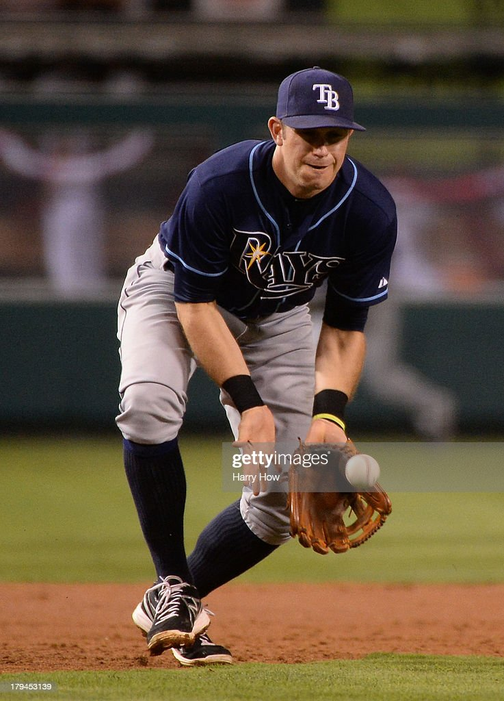 <a gi-track='captionPersonalityLinkClicked' href=/galleries/search?phrase=Evan+Longoria&family=editorial&specificpeople=2349329 ng-click='$event.stopPropagation()'>Evan Longoria</a> #3 of the Tampa Bay Rays makes a stop of groundball from Luis Jimenez #18 of the Los Angeles Angels leading to an out during the second inning at Angel Stadium of Anaheim on September 3, 2013 in Anaheim, California.