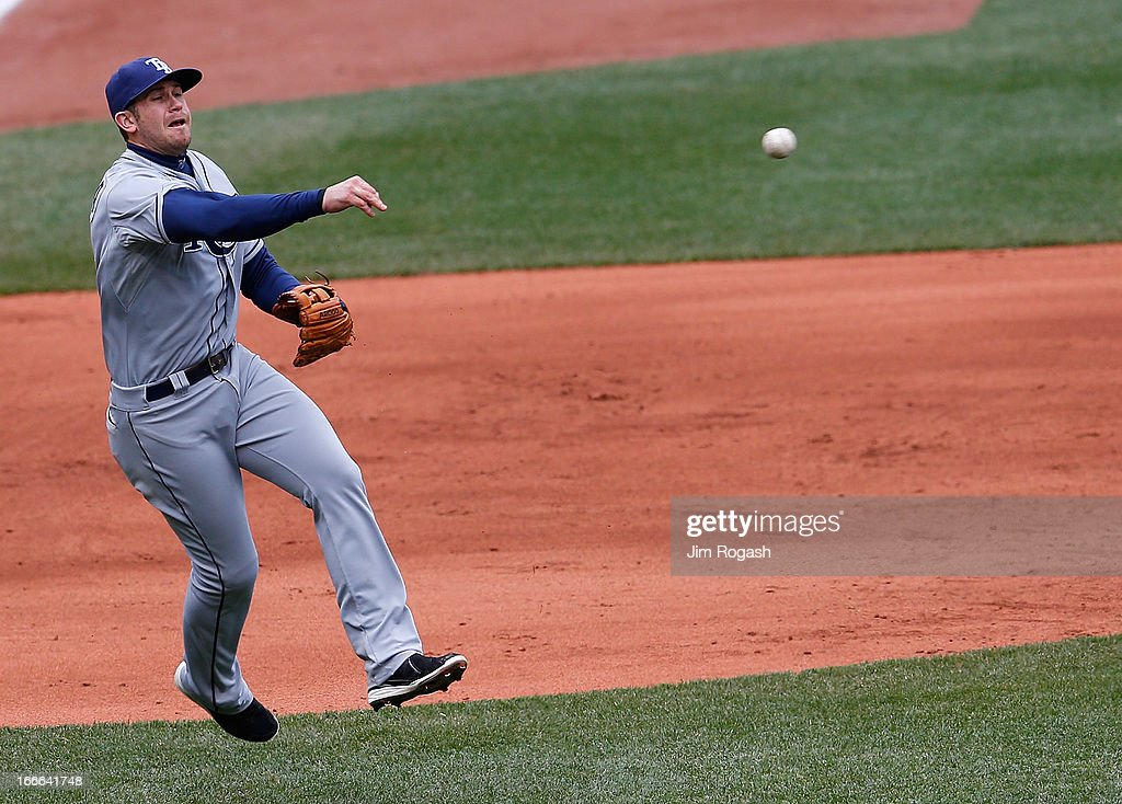 <a gi-track='captionPersonalityLinkClicked' href=/galleries/search?phrase=Evan+Longoria&family=editorial&specificpeople=2349329 ng-click='$event.stopPropagation()'>Evan Longoria</a> #3 of the Tampa Bay Rays makes an assist in the fourth inning on a ball hit by Dustin Pedroia #15 of the Boston Red Sox at Fenway Park on April 14, 2013 in Boston, Massachusetts.