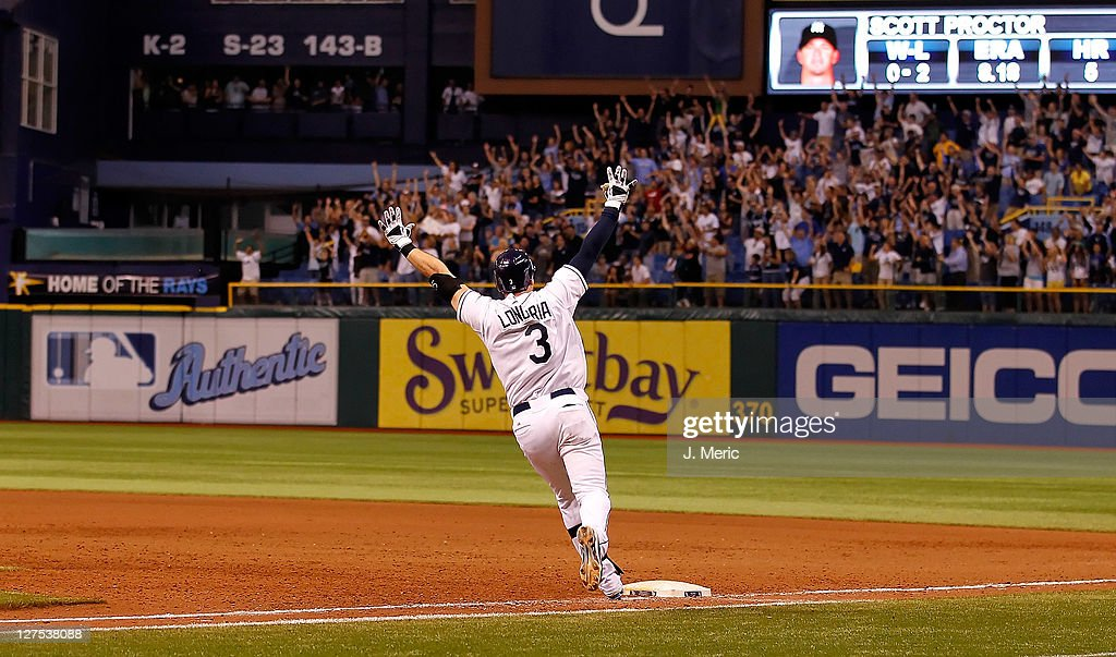 <a gi-track='captionPersonalityLinkClicked' href=/galleries/search?phrase=Evan+Longoria&family=editorial&specificpeople=2349329 ng-click='$event.stopPropagation()'>Evan Longoria</a> #3 of the Tampa Bay Rays rounds the bases after his game-winning walk off home run in the twelfth inning against the New York Yankees during the game at Tropicana Field on September 28, 2011 in St. Petersburg, Florida.