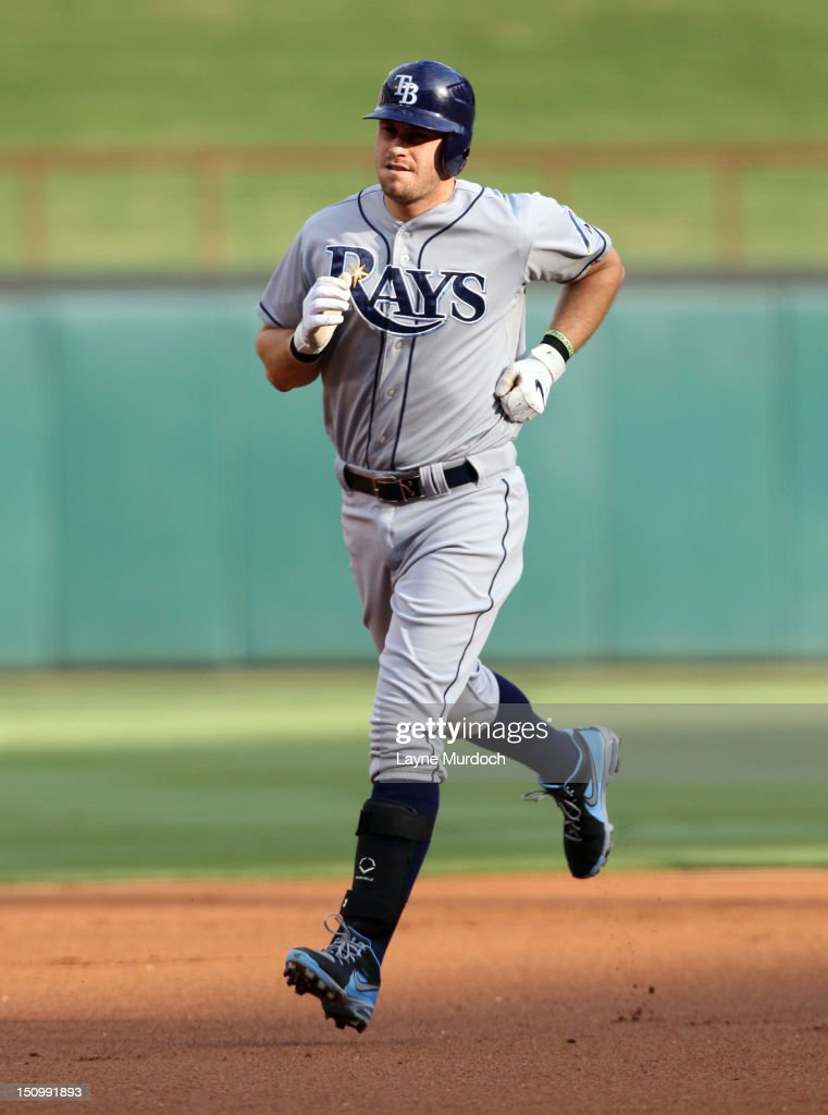 <a gi-track='captionPersonalityLinkClicked' href=/galleries/search?phrase=Evan+Longoria&family=editorial&specificpeople=2349329 ng-click='$event.stopPropagation()'>Evan Longoria</a> #3 of the Tampa Bay Rays rounds the bases after hitting a two-run homer against Matt Harrison of the Texas Rangers on August 29, 2012 at the Rangers Ballpark in Arlington in Arlington, Texas.
