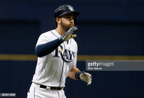 Evan Longoria of the Tampa Bay Rays rounds third base after hitting a home run off of pitcher Dylan Bundy of the Baltimore Orioles during the third...