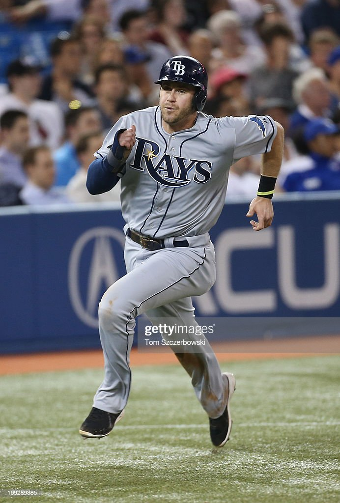 Evan Longoria #3 of the Tampa Bay Rays runs home to score the go-ahead run in the ninth inning on an RBI single by James Loney #21 during MLB game action against the Toronto Blue Jays on May 22, 2013 at Rogers Centre in Toronto, Ontario, Canada.