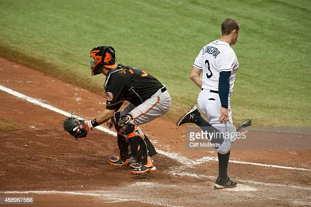 Evan Longoria of the Tampa Bay Rays scores in the fifth inning past catcher Caleb Joseph of the Baltimore Orioles September 18 2015 at Tropicana...