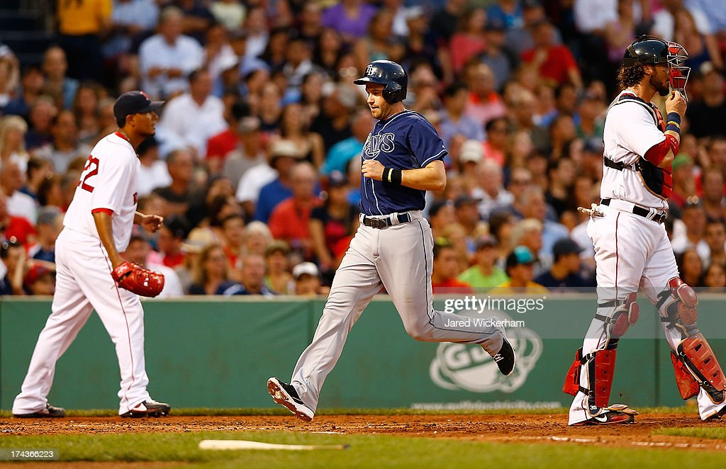 Evan Longoria #3 of the Tampa Bay Rays scores past Felix Doubront #22 and Jarrod Saltalamacchia #39 of the Boston Red Sox in the third inning during the game on July 24, 2013 at Fenway Park in Boston, Massachusetts.