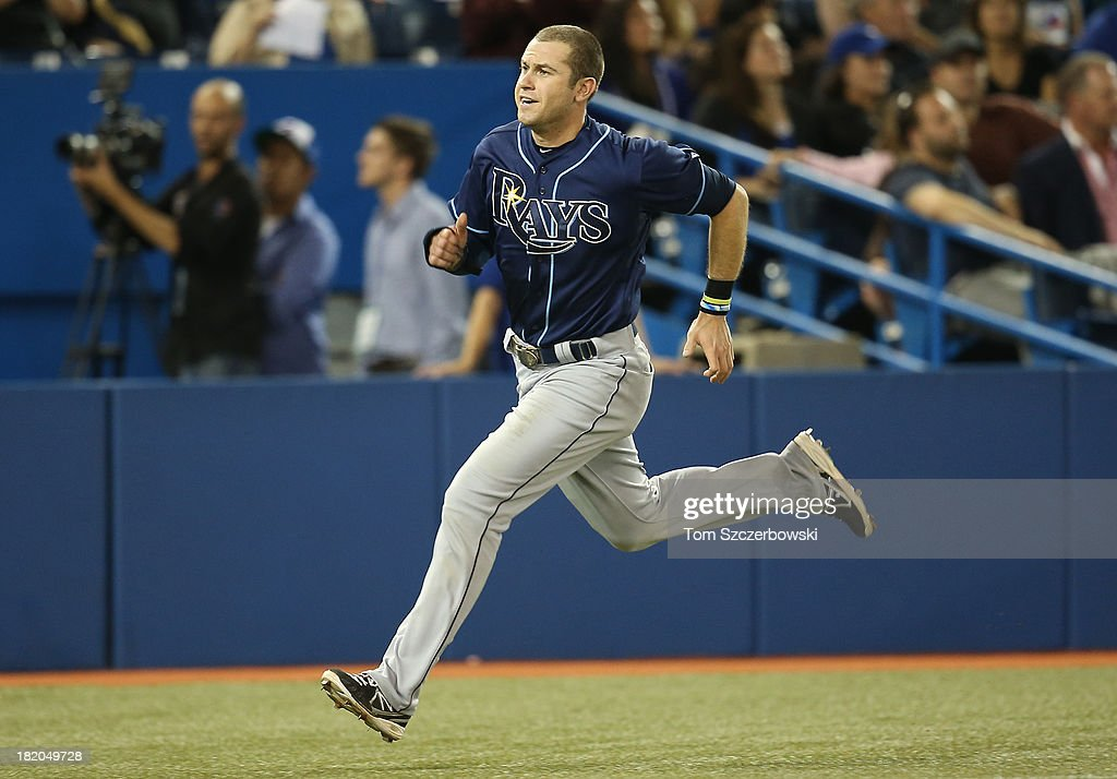 <a gi-track='captionPersonalityLinkClicked' href=/galleries/search?phrase=Evan+Longoria&family=editorial&specificpeople=2349329 ng-click='$event.stopPropagation()'>Evan Longoria</a> #3 of the Tampa Bay Rays scores the third run in the ninth inning during MLB game action against the Toronto Blue Jays on September 27, 2013 at Rogers Centre in Toronto, Ontario, Canada.