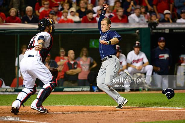 Evan Longoria of the Tampa Bay Rays slides home to score after Desmond Jennings of the Tampa Bay Rays hit an RBI double to left field against Danny...