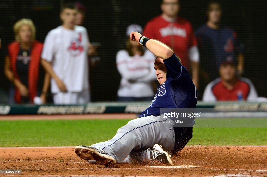 <a gi-track='captionPersonalityLinkClicked' href=/galleries/search?phrase=Evan+Longoria&family=editorial&specificpeople=2349329 ng-click='$event.stopPropagation()'>Evan Longoria</a> #3 of the Tampa Bay Rays slides to home to score after Desmond Jennings #8 of the Tampa Bay Rays hit an RBI double to left field against Danny Salazar #31 of the Cleveland Indians in the fourth inning during the American League Wild Card game at Progressive Field on October 2, 2013 in Cleveland, Ohio.