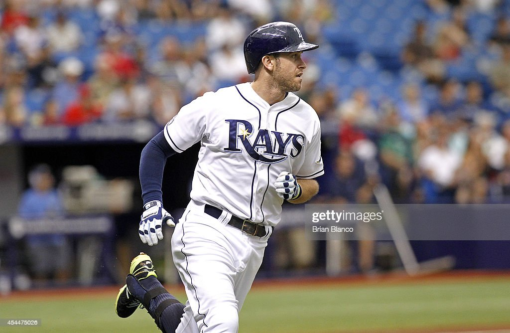 <a gi-track='captionPersonalityLinkClicked' href=/galleries/search?phrase=Evan+Longoria&family=editorial&specificpeople=2349329 ng-click='$event.stopPropagation()'>Evan Longoria</a> #3 of the Tampa Bay Rays sprints toward first base after hitting a two-run single off of pitcher Rubby De La Rosa #62 of the Boston Red Sox to score Wil Myers and Ben Zobrist during the third inning of a game on September 1, 2014 at Tropicana Field in St. Petersburg, Florida.
