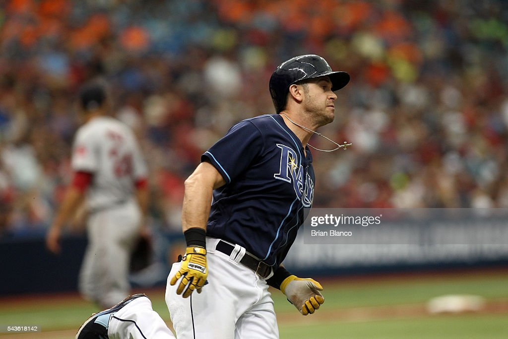 <a gi-track='captionPersonalityLinkClicked' href=/galleries/search?phrase=Evan+Longoria&family=editorial&specificpeople=2349329 ng-click='$event.stopPropagation()'>Evan Longoria</a> #3 of the Tampa Bay Rays sprints toward first base after hitting an RBI double off of pitcher David Price of the Boston Red Sox to score Logan Forsythe during the third inning of a game on June 29, 2016 at Tropicana Field in St. Petersburg, Florida.