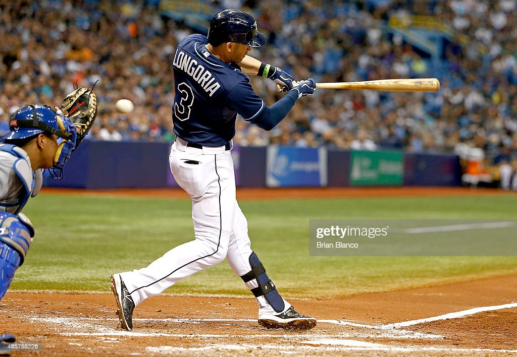 Evan Longoria of the Tampa Bay Rays strikes out swinging with the bases loaded in front of catcher Salvador Perez of the Kansas City Royals to end...
