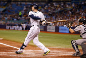 Evan Longoria of the Tampa Bay Rays strikes out swinging with two men on base in front of catcher Francisco Cervelli of the New York Yankees to end...
