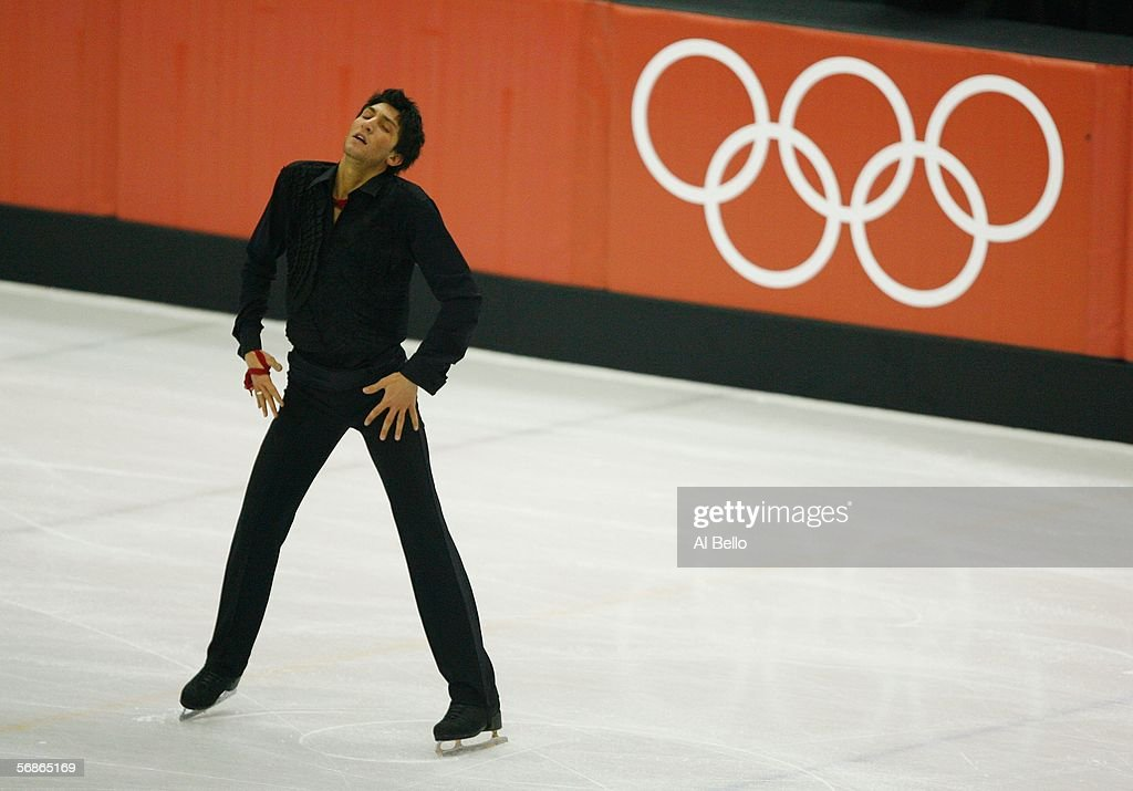 Evan Lysacek of the United States competes in the Men's Free Skate Program Final during Day 6 of the Turin 2006 Winter Olympic Games on February 16...