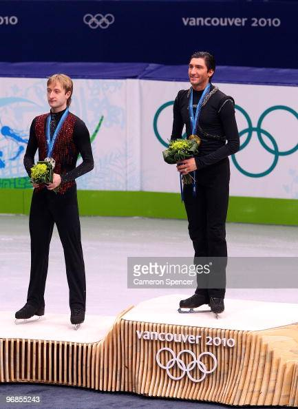 Evan Lysacek of the United States poses after winning the gold medal with silver medalist Evgeni Plushenko of Russia in the men's figure skating free...