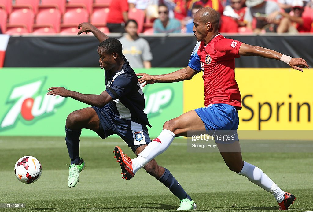 Evan Mariano #6 of Belize and Carlos Johnson #16 of Costa Rica chase the ball during the first half of a CONCACAF Gold Cup match July 13, 2013 at Rio Tinto Stadium in Sandy, Utah.