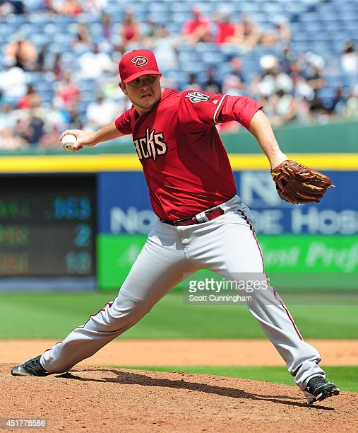 Evan Marshall of the Arizona Diamondbacks throws a seventh inning pitch against the Atlanta Braves at Turner Field on July 6 2014 in Atlanta Georgia