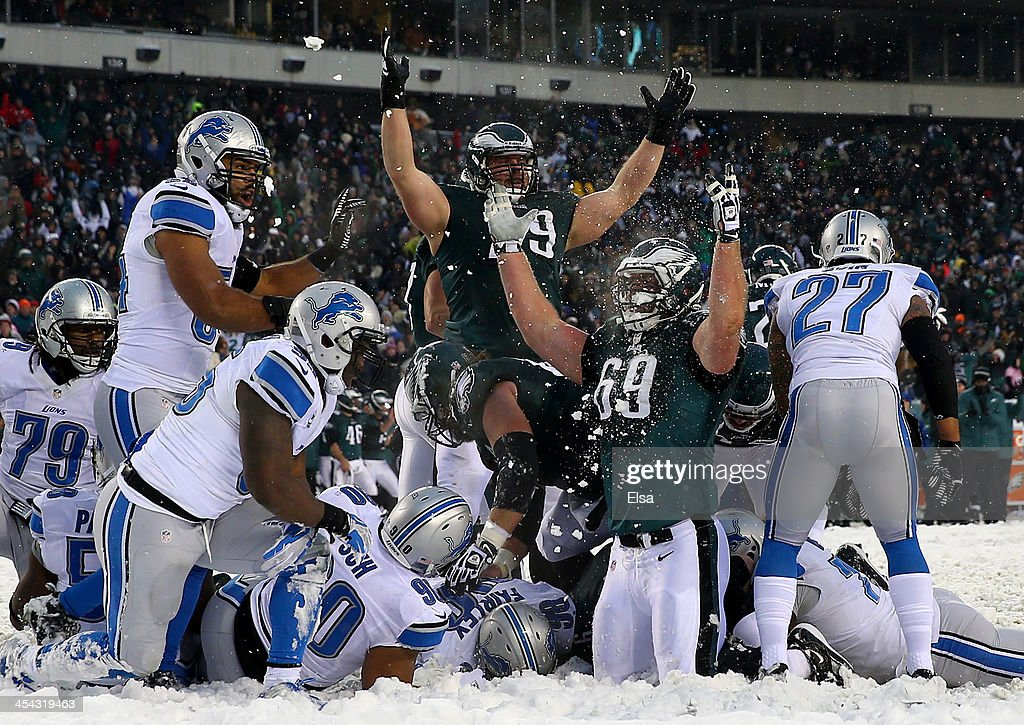 Evan Mathis #69 and Todd Herremans #79 of the Philadelphia Eagles celebrate a touchdown in the fourth quarter against the Detroit Lions on December 8, 2013 at Lincoln Financial Field in Philadelphia, Pennsylvania.The Philadelphia Eagles defeated the Detroit Lions 34-20.