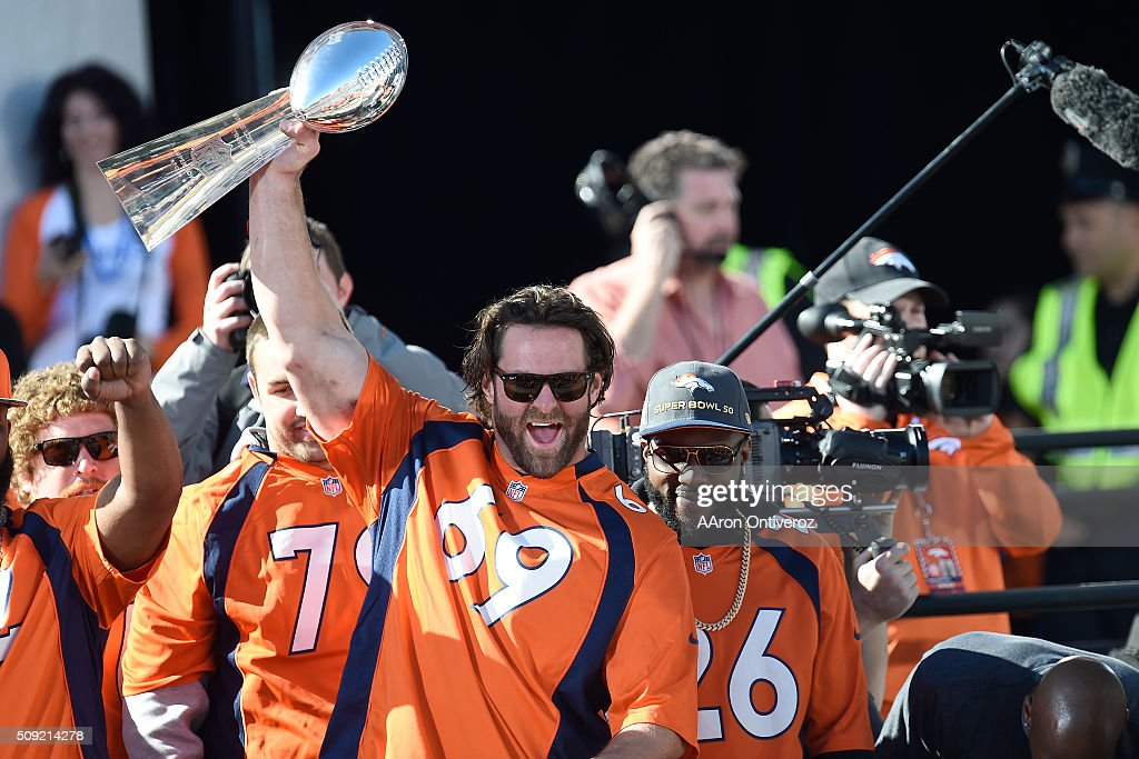 Evan Mathis hoists the Lombardi Trophy during the Denver Broncos Super Bowl championship celebration and parade on Tuesday February 9, 2016.