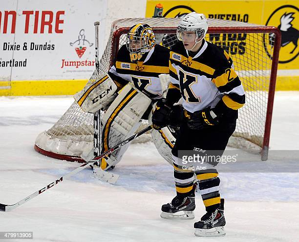 Evan McEneny and goalie Lucas Peressini of the Kingston Frontenacs guard the crease against the Mississauga Steelheads during game action on March 16...