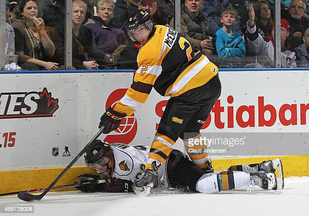 Evan McEneny of the Kingston Frontenacs takes down Mitchell Marner of the London Knights in an OHL game at Budweiser Gardens on November 29 2014 in...