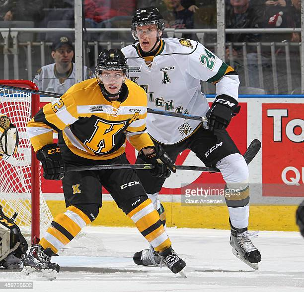 Evan McEneny of the Kingston Frontenacs tries to contain Michael McCarron of the London Knights in an OHL game at Budweiser Gardens on November 29...